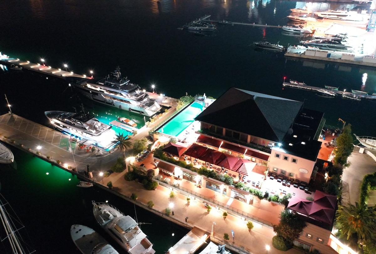 A night view of Superyachts docks at Porto Lotti